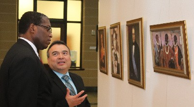 Deon Williams and Nestor Mendez view Photo exhibition of leaders of African descent in the Americas at OAS